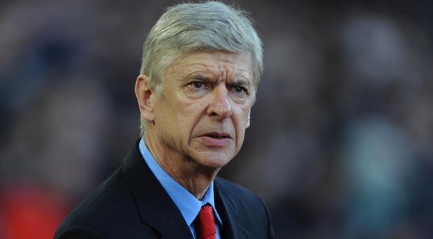A football supporter has been charged by police after allegedly confronting Arsene Wenger, pictured