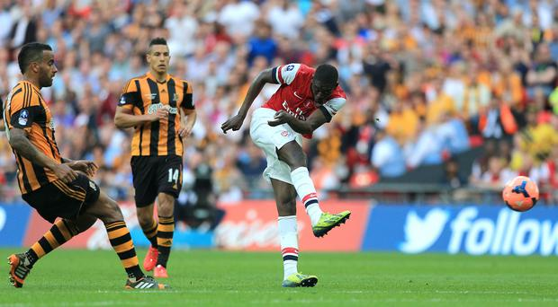 Tom Huddlestone, left, wants to be playing with Yaya Sanogo, right, and not against him