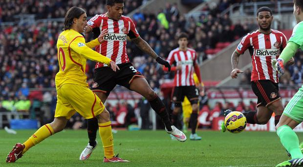 Lazar Markovic, left, scores Liverpool's goal against Sunderland