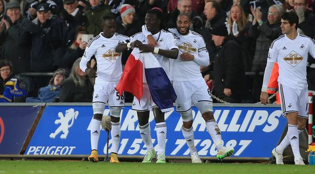 Bafetimbi Gomis, centre, celebrated Swansea's equaliser with a tribute to the victims of the terrorist attacks in Paris