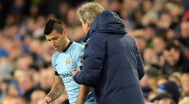 Manuel Pellegrini, right, is looking forward to being able to field a fit-again Sergio Aguero, left