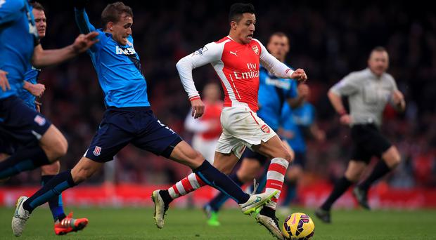 Alexis Sanchez, right, produced another virtuoso display in Sunday's 3-0 victory over Stoke