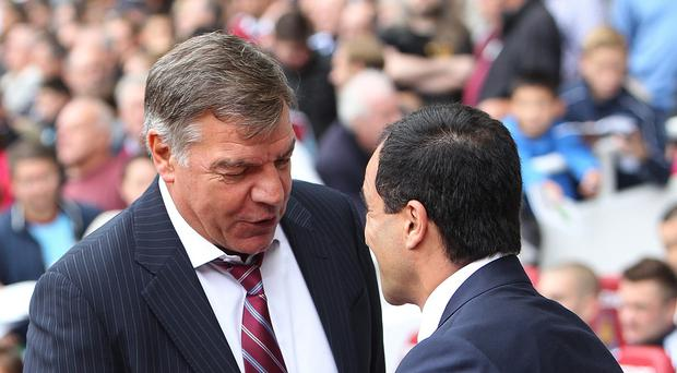 West Ham manager Sam Allardyce, left, believes he is a more flexible boss than Everton's Roberto Martinez