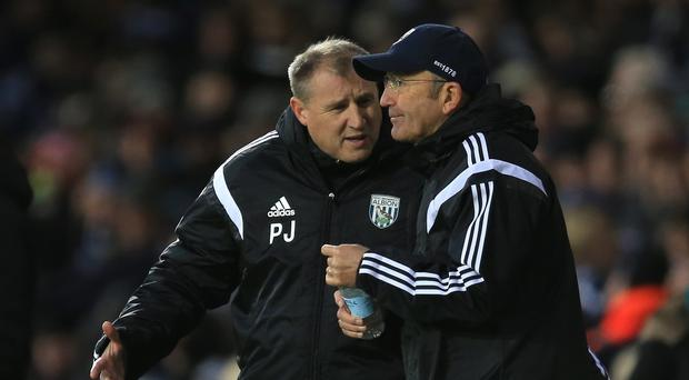 Paul Jewell, pictured left, has placed the circumstances around his exit from West Brom in the hands of his lawyer