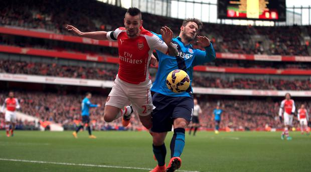 Mathieu Debuchy suffered his latest injury after this clash with Stoke's Marko Arnautovic