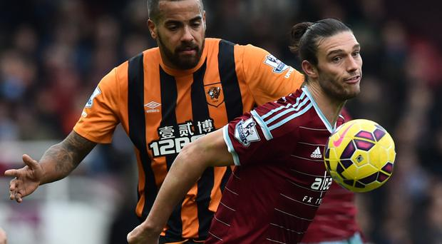 West Ham striker Andy Carroll vies with Hull's Tom Huddlestone