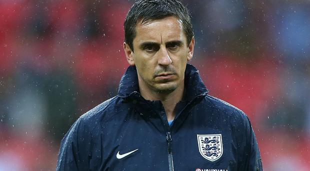 England coach Gary Neville has spoken out about Manchester United's defensive problems