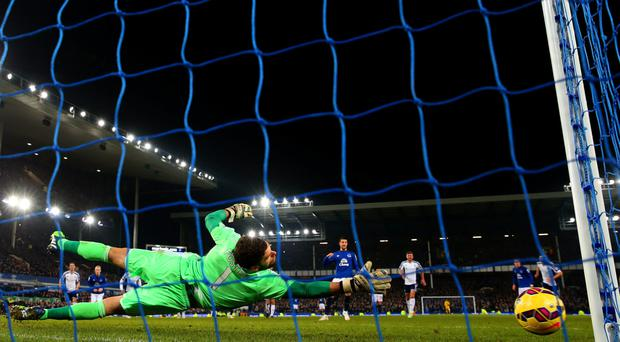 Near and far: Everton's Kevin Mirallas misses the crucial penalty against West Brom at Goodison