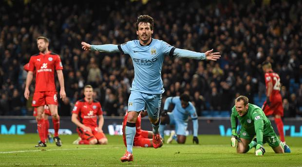 It's there: David Silva opens the scoring as Manchester City beat Leicester