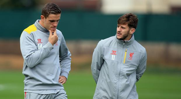 Adam Lallana, right, believes captaincy is bringing the best out of Jordan Henderson, left