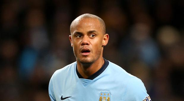 Vincent Kompany, pictured, was allegedly involved in a half-time bust-up with team-mate Fernandinho