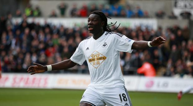 Swansea striker Bafetimbi Gomis is 'ready to go' after collapsing on the field at Tottenham nine days ago