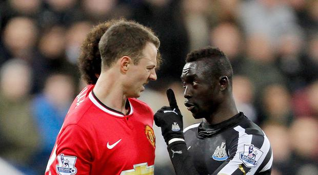 Newcastle head coach John Carver has admitted he could not defend striker Papiss Cisse, right, for spitting at Jonny Evans in retaliation