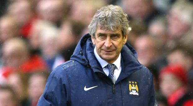 Manuel Pellegrini insists his Man City players will never surround referees in an attempt to influence decisions