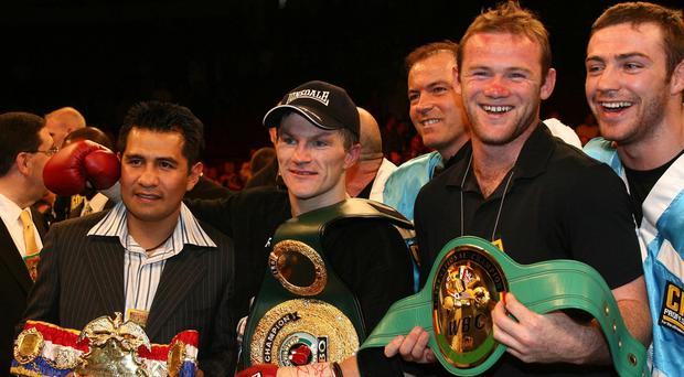 Wayne Rooney, second right, in the ring with Ricky Hatton, second left, in 2007