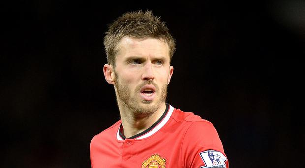 Manchester United's Michael Carrick has signed a new one-year deal
