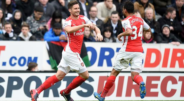 Olivier Giroud, left, struck twice inside four minutes for Arsenal