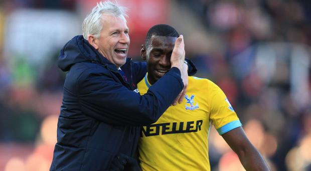 Alan Pardew, left, celebrates another win for Crystal Palace
