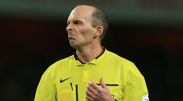 Mike Dean, pictured, incurred the anger of Leicester boss Nigel Pearson
