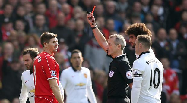 Liverpool's Steven Gerrard (second left) is shown the red card by referee Martin Atkinson during the Barclays Premier League match at Anfield, Liverpool.