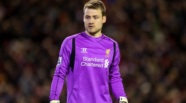 Liverpool's Simon Mignolet has not given up hope of a top-four finish