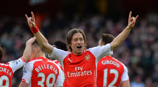 Tomas Rosicky hinted he could stay on at Arsenal next season