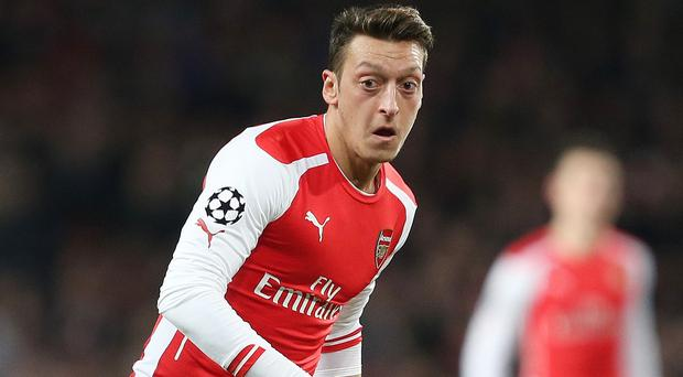 Arsenal playmaker Mesut Ozil has his sights set on becoming the best player in the world