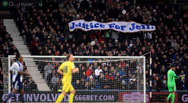 West Brom fans, here with a 'Justice for Jeff' banner, have been applauding in the ninth minute of every game to remember Astle