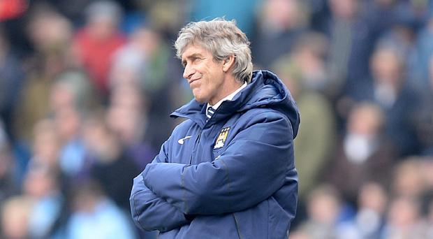 Manchester City manager Manuel Pellegrini is determined to fight to the end