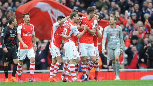 Hector Bellerin, middle, opened the scoring for Arsenal