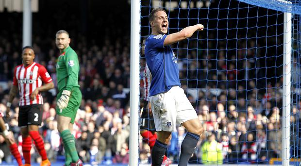 Everton's Phil Jagielka celebrates scoring the only goal of the game
