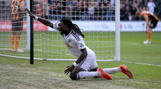 Swansea City's Bafetibis Gomis celebrates scoring his side's third goal during the Barclays Premier League match at the Liberty Stadium, Swansea.