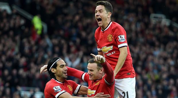Rooney, middle, scored in Manchester United's win