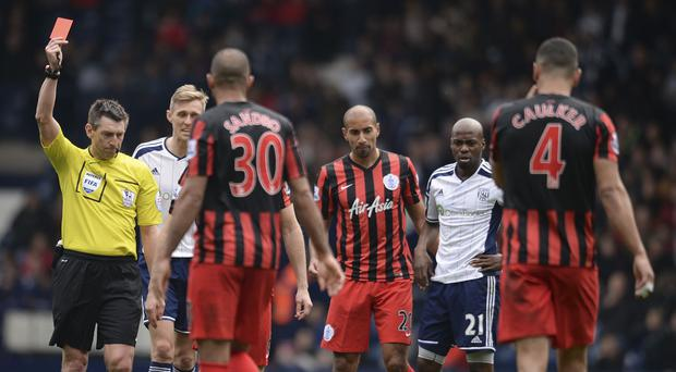 Referee Lee Probert sends off Youssouf Mulumbu, number 21, after his challenge on QPR's Joey Barton during the Hoops' 4-1 win
