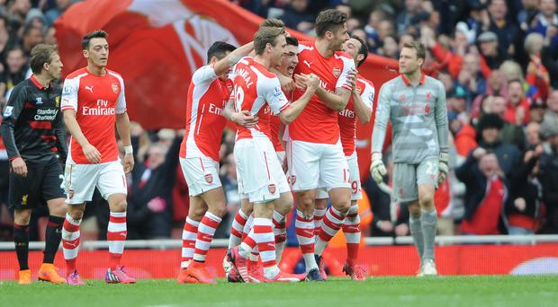 Hector Bellerin, centre, celebrates with team-mates after scoring his sides first goal of the game