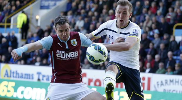 Harry Kane, right, was kept quiet by Michael Duff, left