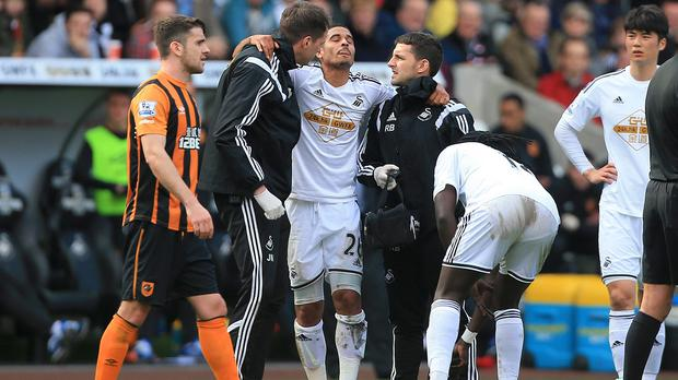 Kyle Naughton, centre, will be sidelined for around six weeks after sustaining ankle ligament damage against Hull
