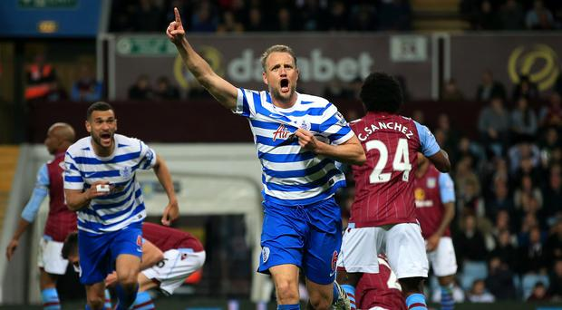 Clint Hill believes the pressure is on QPR's relegation rivals