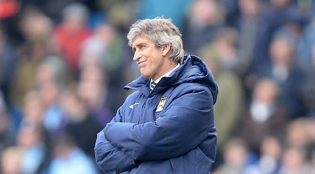 Manchester City manager Manuel Pellegrini has attempted to play down his team's problems