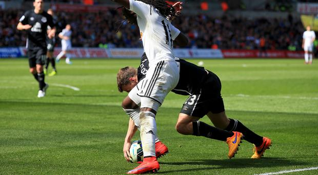 Everton's Seamus Coleman handles the ball under pressure from Swansea's Marvin Emnes