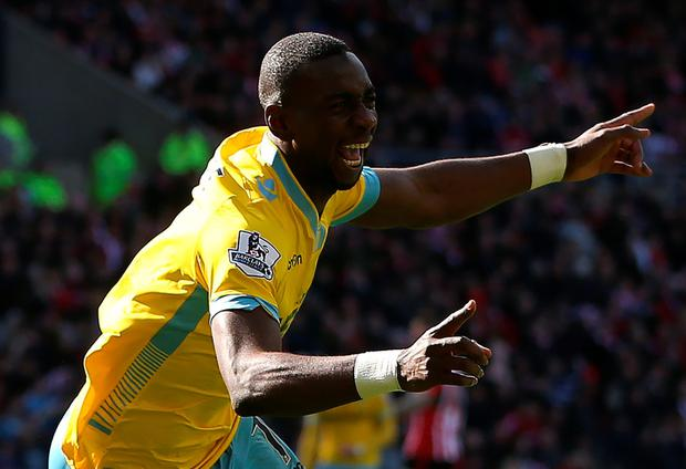 Treble yell: Yannick Bolasie salutes his hat-trick for Palace