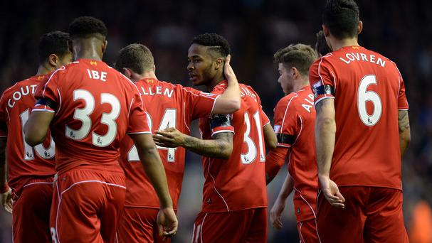 Raheem Sterling, middle, scored in Liverpool's win