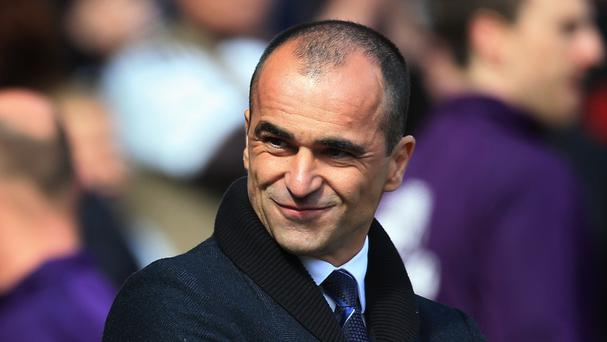 Everton manager Roberto Martinez, pictured, has urged Antolin Alcaraz and Sylvain Distin to prove they are worth new contracts