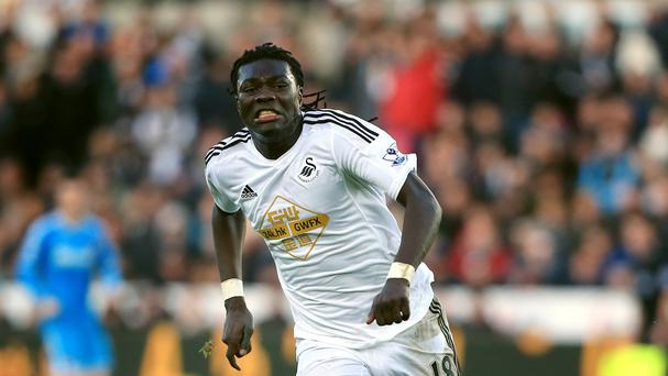 Swansea striker Bafetimbi Gomis has been ruled out for three to four weeks after picking up a hamstring injury
