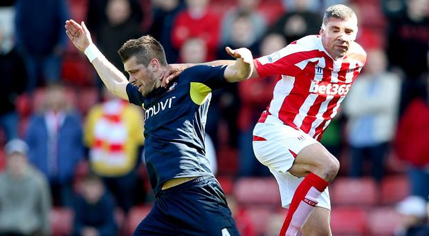 Morgan Schneiderlin, left, has not given up hopes of a Champions League finish