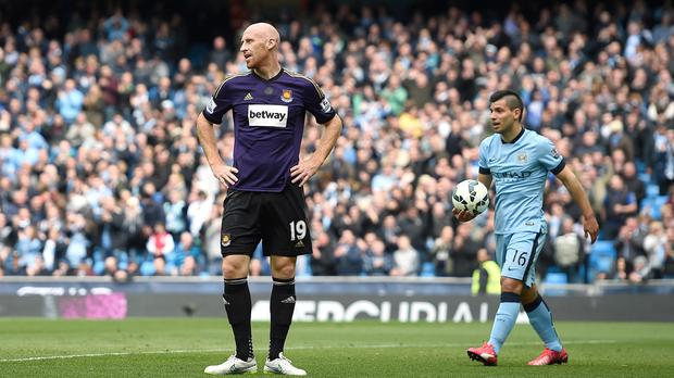 James Collins stands dejected after gifting Manchester City their opener