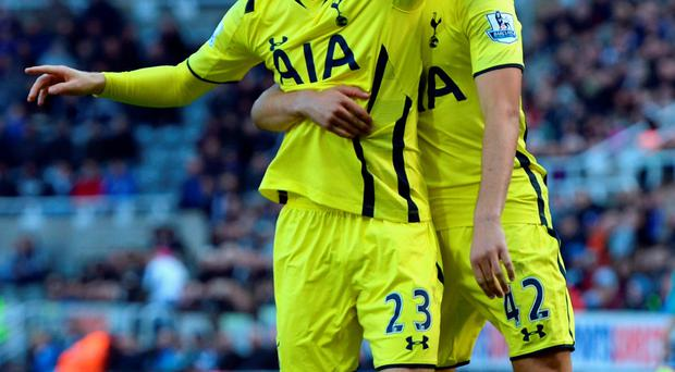 On target: Christian Eriksen celebrates Spurs' second goal