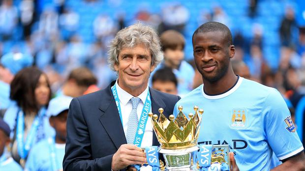 Manuel Pellegrini (left) thinks Yaya Toure (right) still has a challenge at Manchester City