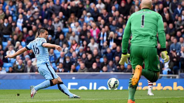 Sergio Aguero scores Manchester City's first goal against Aston Villa