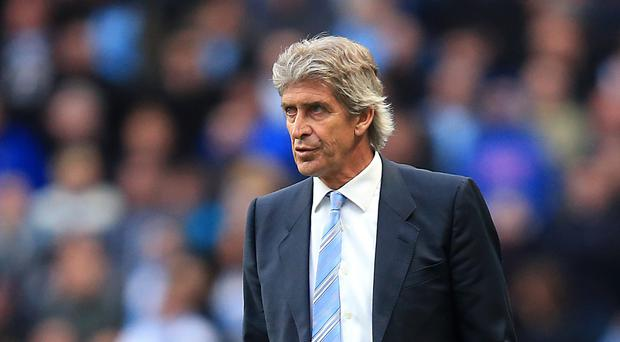 Seeing the funny side: Manchester City boss Manuel Pellegrini